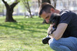 Man and his dog pet in park